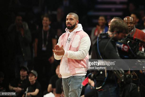 Rap artist Drake enjoys watching the Verizon Slam Dunk Contest as part of the 2016 NBA All Star Weekend on February 12 2016 at Air Canada Centre in...