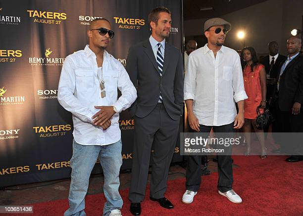 Rap Artist TI actor Paul Walker and actor Michael Ealy attend the Takers premiere at Regal Atlantic Station on August 24 2010 in Atlanta Georgia