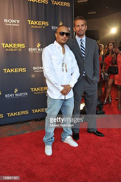 Rap Artist/Actor Tip 'TI' Harris and actor Paul Walker attend the Takers premiere at Regal Atlantic Station on August 24 2010 in Atlanta Georgia