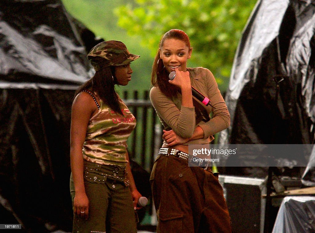 Rap artists Kiely Williams (R) and Naturi Naughton with 3LW perform at Music Midtown May 3, 2003 in Atlanta, Ga. Music Midtown features over 120 international, national and local musical acts performing over three days.