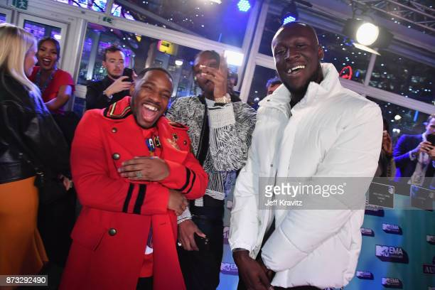 Rap Duo Krept and Konan pose with Rapper Stormzy at the MTV EMAs 2017 held at The SSE Arena Wembley on November 12 2017 in London England