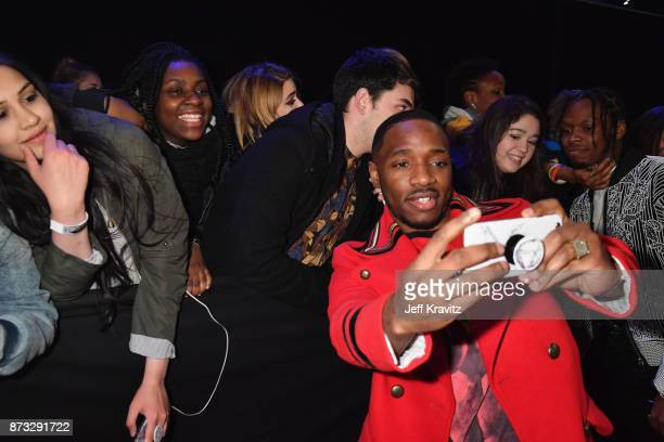 Rap Duo Krept and Konan take selfies with fans as they attend the MTV EMAs 2017 held at The SSE Arena Wembley on November 12 2017 in London England
