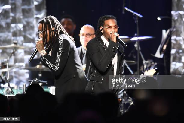 Rap group Migos performs during the traditionnal Clive Davis party on the eve of the 60th Annual Grammy Awards on January 28 in New York / AFP PHOTO...