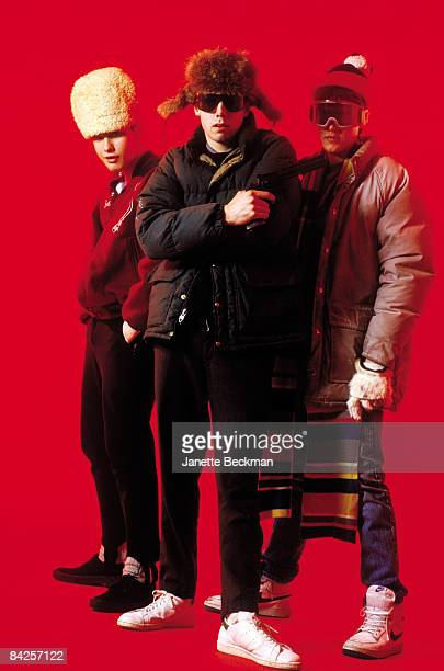 Rap group the Beastie Boys posing in funky outfits, from left to right Mike Diamond , Adam Yauch holding a gun, and Adam Horovitz , 1985. New York.