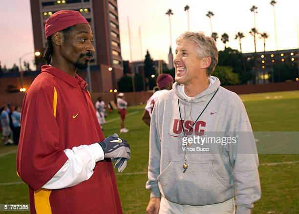 Rap music artist Snoop Dogg and head coach Pete Carroll of the University of Southern California football team attend practice while filming the mtvU...
