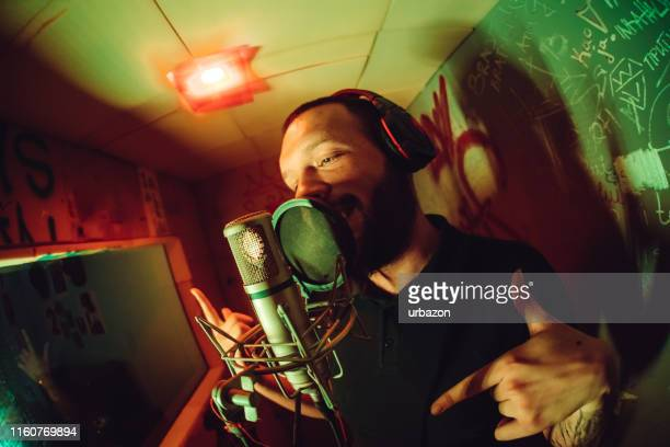 rap musician in studio - pop music stock pictures, royalty-free photos & images