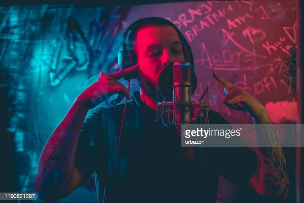 rap musician in studio - hip hop music stock pictures, royalty-free photos & images
