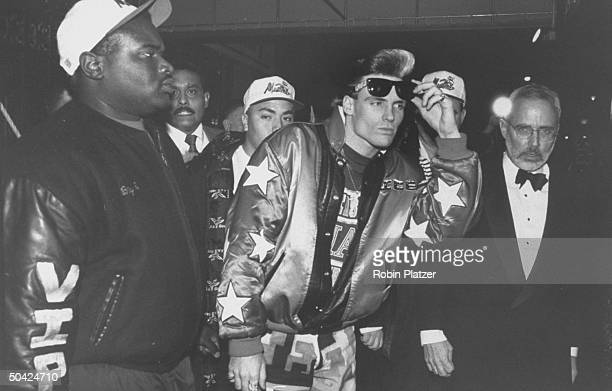 Rap singer Vanilla Ice w bodyguards on the way to the Grammy Awards