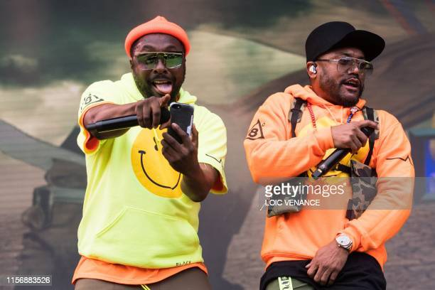Rap singers Will.I.Am and apl.de.ap perform with The Black Eyed Peas group during the Vieilles Charrues music festival on July 20, 2019 in...