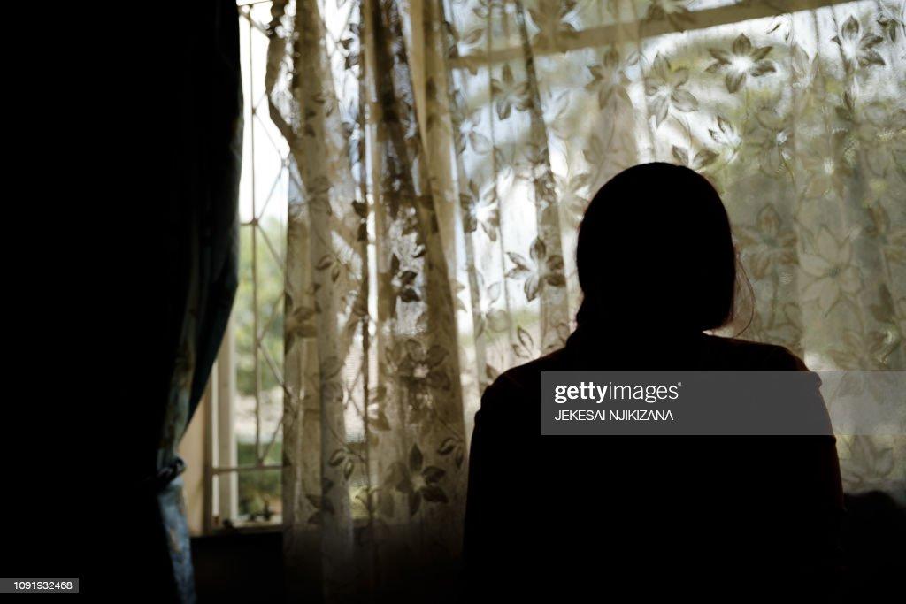 ZIMBABWE-UNREST-ASSAULT : News Photo