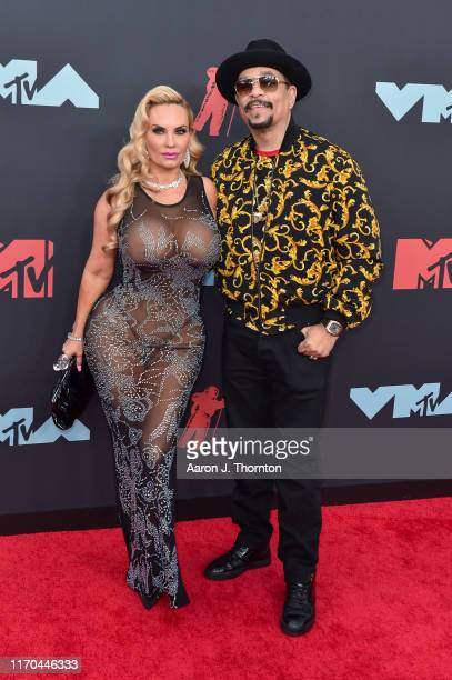 Raper IceT and his wife Coco attend the 2019 MTV Video Music Awards red carpet at Prudential Center on August 26 2019 in Newark New Jersey
