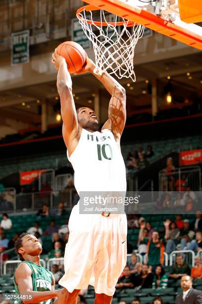 Raphael Akpejiori of the Miami Hurricanes dunks the ball against the Stetson Hatters on December 12 2010 at the BankUnited Center in Coral Gables...