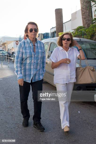 Raphael and Natalia Figueroa attend the funeral chapel for ex motorcyclist Angel Nieto at Tanatorio de Ibiza on August 4 2017 in Ibiza Spain