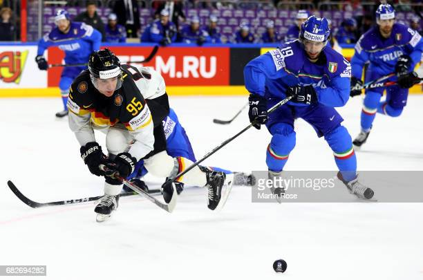 Raphael Andergassen of Italy challenges Frederik Tiffels of Germany for the puck during the 2017 IIHF Ice Hockey World Championship game between...