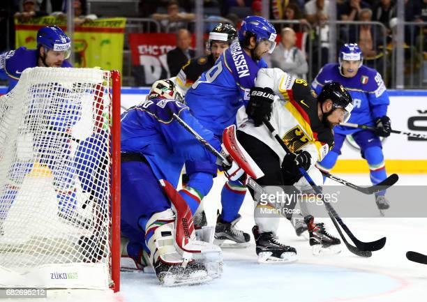 Raphael Andergassen of Italy challenges Yannic Seidenberg of Germany for the puck during the 2017 IIHF Ice Hockey World Championship game between...