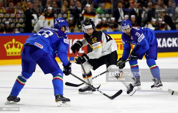 Raphael Andergassen of Italy challenges Yasin Ehliz of Germany for the puck during the 2017 IIHF Ice Hockey World Championship game between Italy and...