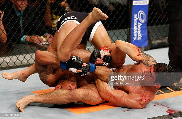 Raphael Assuncao attempts to secure an arm bar submission against Vaughan Lee in their bantamweight fight during the UFC on FUEL TV event at Paulo...