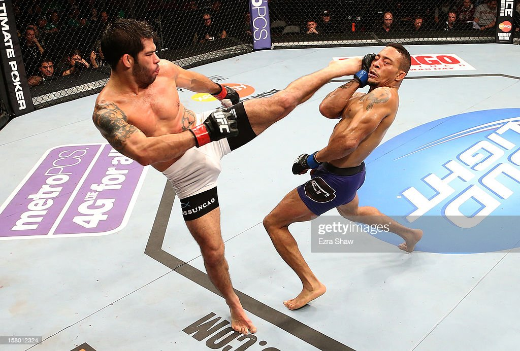 Raphael Assuncao kicks Mike Easton during their bantamweight bout at the UFC on FOX event on December 8, 2012 at Key Arena in Seattle, Washington.