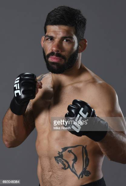 Raphael Assuncao of Brazil poses for a portrait backstage after his victory over Marlon Moraes during the UFC 212 event at Jeunesse Arena on June 3...