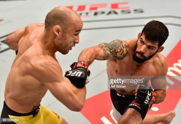 Raphael Assuncao of Brazil punches Marlon Moraes in their bantamweight bout during the UFC 212 event at Jeunesse Arena on June 3 2017 in Rio de...