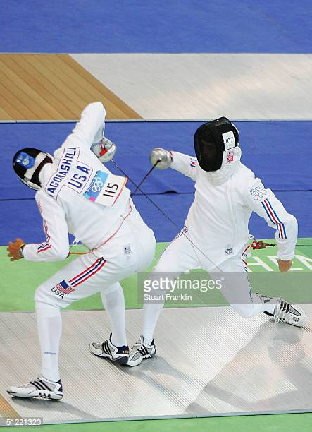 Raphael Astier of France and Vakhtang Iagorashvili of the United States duel in the men's fencing event of the modern pentathlon on August 26 2004...