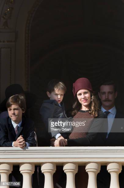 Raphael Casiraghi and Charlotte Casiraghi greet the crowd from the palace's balcony during on November 19 2017 in Monaco Monaco