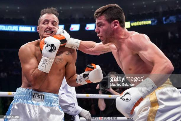Raphael Courchesne of Canada punches Ivan Banach of Argentina during their Super Welterweight fight at the Videotron Center on May 26 2018 in Quebec...