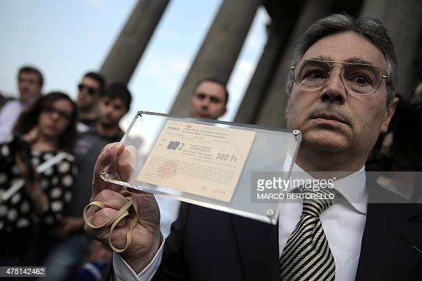 Raphael Desantis, a survivor of the Heysel tragedy, holds his ticket from the match ahead of a mass at Gran Madre di Dio church in Turin on May 29 to...