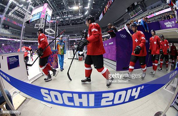 Raphael Diaz of Switzerland walks to the ice with his team before the Men's Ice Hockey Preliminary Round Group C game against Sweden on day seven of...