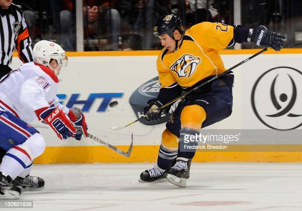 Raphael Diaz of the Montreal Canadiens skates against Jordin Tootoo of the Nashville Predators at the Bridgestone Arena on November 12 2011 in...
