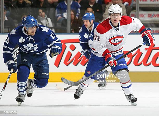 Raphael Diaz of the Montreal Canadiens skates along side Matthew Lombardi of the Toronto Maple Leafs in a game on February 11 2012 at the Air Canada...