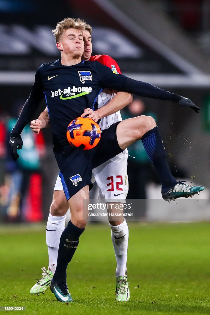 Raphael Framberger #32 of Augsburg and Maximilian Mittelstadt #17 of Hertha Berlin battle for the ball during the Bundesliga match between FC Augsburg and Hertha BSC at WWK-Arena on December 10, 2017 in Augsburg, Germany.