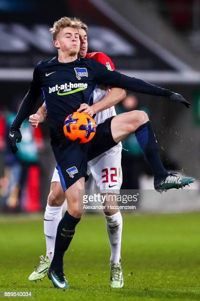 Raphael Framberger of Augsburg and Maximilian Mittelstadt of Hertha Berlin battle for the ball during the Bundesliga match between FC Augsburg and...