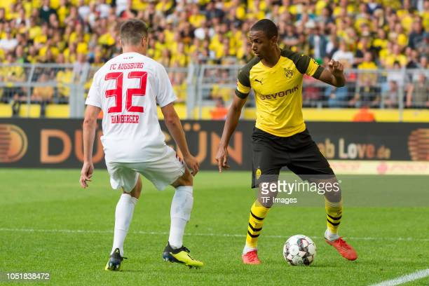 Raphael Framberger of FC Augsburg and Abdou Diallo of Borussia Dortmund battle for the ball during the Bundesliga match between Borussia Dortmund and...