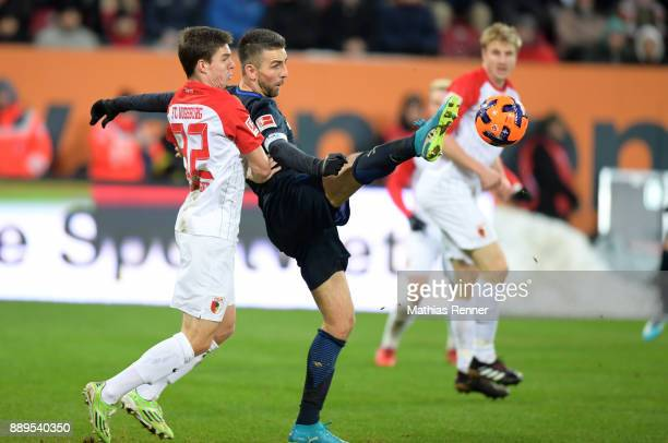 Raphael Framberger of FC Augsburg and Vedad Ibisevic of Hertha BSC during the Bundesliga match between FC Augsburg and Hertha BSC on December 10 2017...