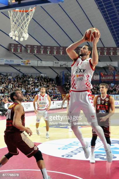 Raphael Gaspardo of The Flexx competes with Bruno Cerella and Andrea De Nicolao of Umana during the LBA Legabasket of Serie A match between Reyer...