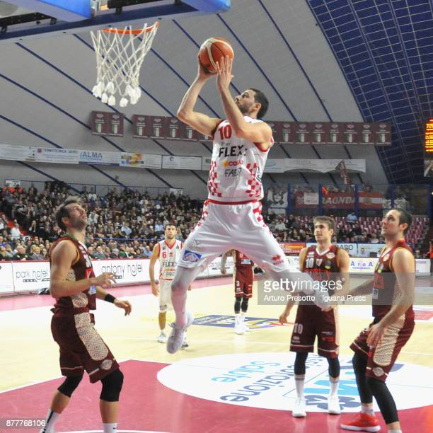Raphael Gaspardo of The Flexx competes with Bruno Cerella and Andrea De Nicolao and Gediminas Orelik of Umana during the LBA Legabasket of Serie A...