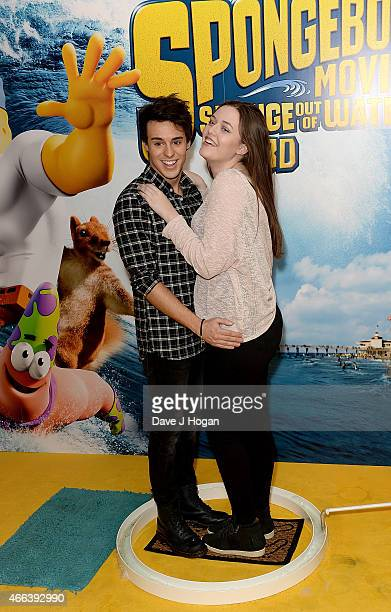 Raphael Gomes and Felicite Tomlinson attend The Spongebob Movie Sponge Out of Water UK Gala screening on March 15 2015 in London England
