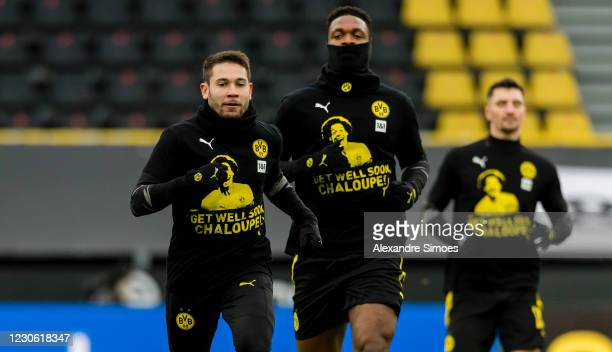 Raphael Guerreiro and Dan-Axel Zagadou of Borussia Dortmund are wearing the warm-up jersey with the well wishes for Axel Witsel prior to the...