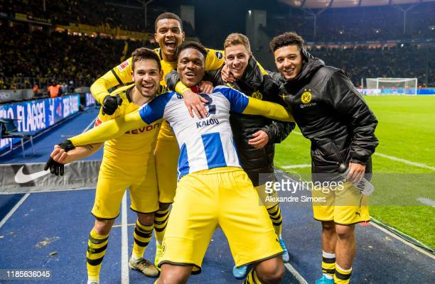Raphael Guerreiro, Dan-Axel Zagadou, Manuel Akanji, an Thorgan Hazard and Jadon Sancho of Borussia Dortmund celebrates after winning the Bundesliga...