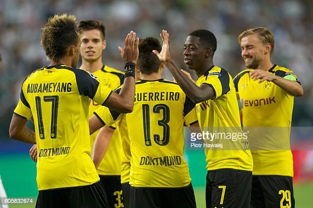 Raphael Guerreiro of Borussia and his team mates celebrate scoring a goal during the UEFA Champions League match between Legia Warszawa and Borussia...