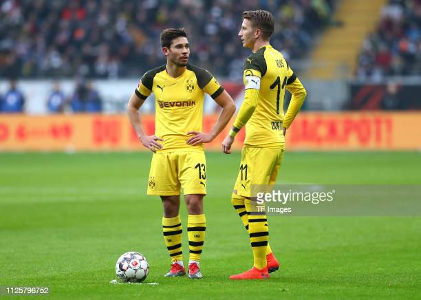 Raphael Guerreiro of Borussia Dortmund and Marco Reus of Borussia Dortmund talk to each other during the Bundesliga match between Eintracht Frankfurt...