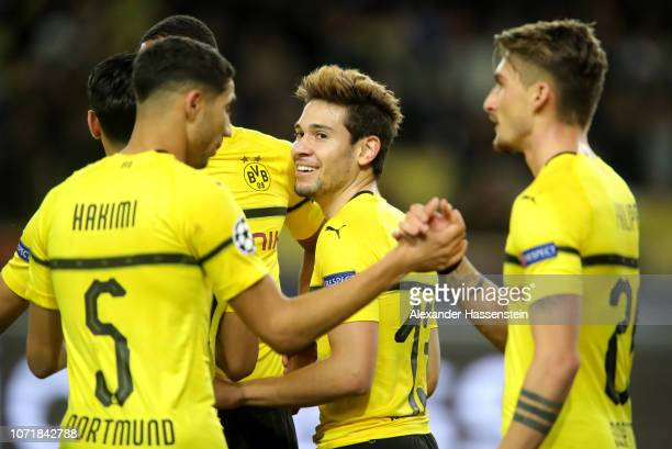 Raphael Guerreiro of Borussia Dortmund celebrates after scoring his team's first goal with team mates during the UEFA Champions League Group A match...