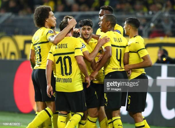 Raphael Guerreiro of Borussia Dortmund celebrates after scoring his team's fourth goal with Axel Witsel of Borussia Dortmund Mario Goetze of Borussia...