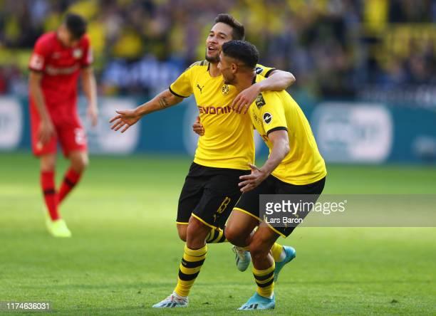 Raphael Guerreiro of Borussia Dortmund celebrates after scoring his team's third goal with team mate Achraf Hakimi during the Bundesliga match...