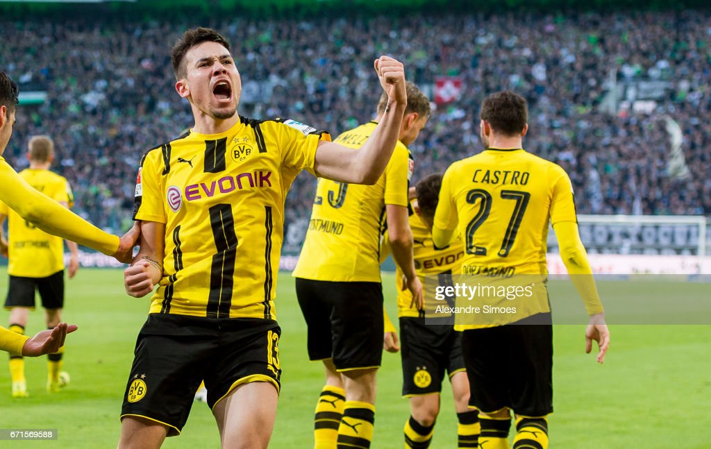 Raphael Guerreiro of Borussia Dortmund celebrates after scoring the winning goal to the 2:3 during the Bundesliga match between Borussia Moenchengladbach and Borussia Dortmund at the Borussia-Park on April 22, 2017 in Moenchengladbach, Germany.