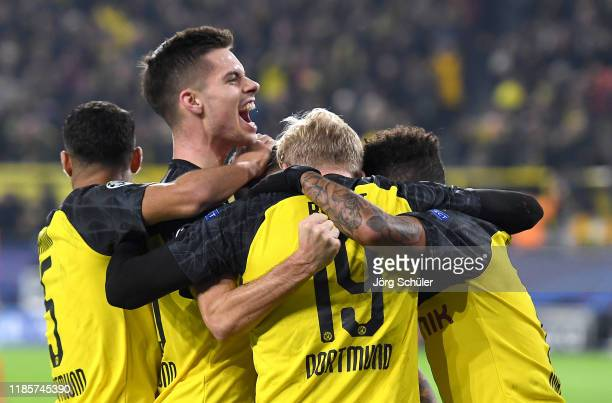 Raphael Guerreiro of Borussia Dortmund celebrates his team's second goal scored by Julian Brandt with his teammates during the UEFA Champions League...