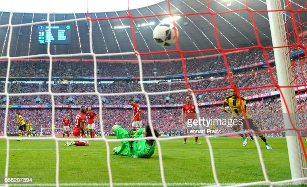 Raphael Guerreiro of Borussia Dortmund celebrates scoring his sides first goal during the Bundesliga match between Bayern Muenchen and Borussia...