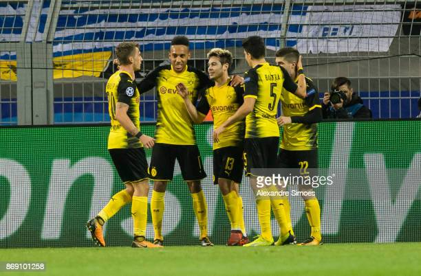 Raphael Guerreiro of Borussia Dortmund celebrates scoring the opening goal together with his team mates during the UEFA Champions League match...