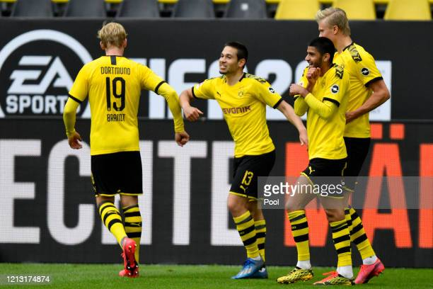 Raphael Guerreiro of Borussia Dortmund celebrates with team mate Julian Brandt after scoring his side's second goal during the Bundesliga match...